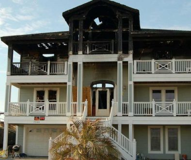 beach house in need of fire damage restoration